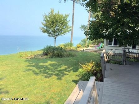 Image is an exterior shot of the described home for sale on Lake Michigan in Stevensville, Michigan.