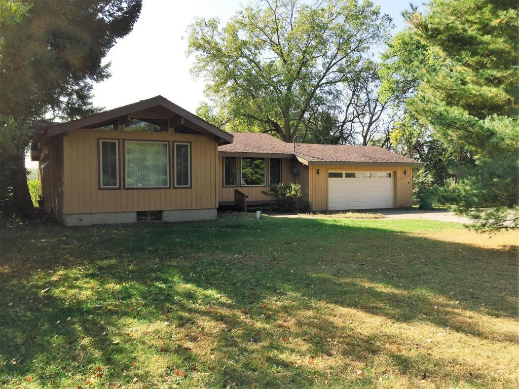 Image is an exterior shot of the described home for sale in Edwardsburg, Michigan.