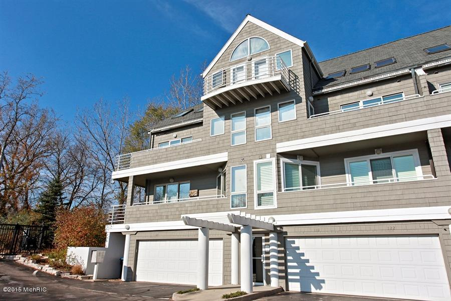 Image is an exterior shot of the below described waterfront home for sale on Lake Michigan in New Buffalo, MI.