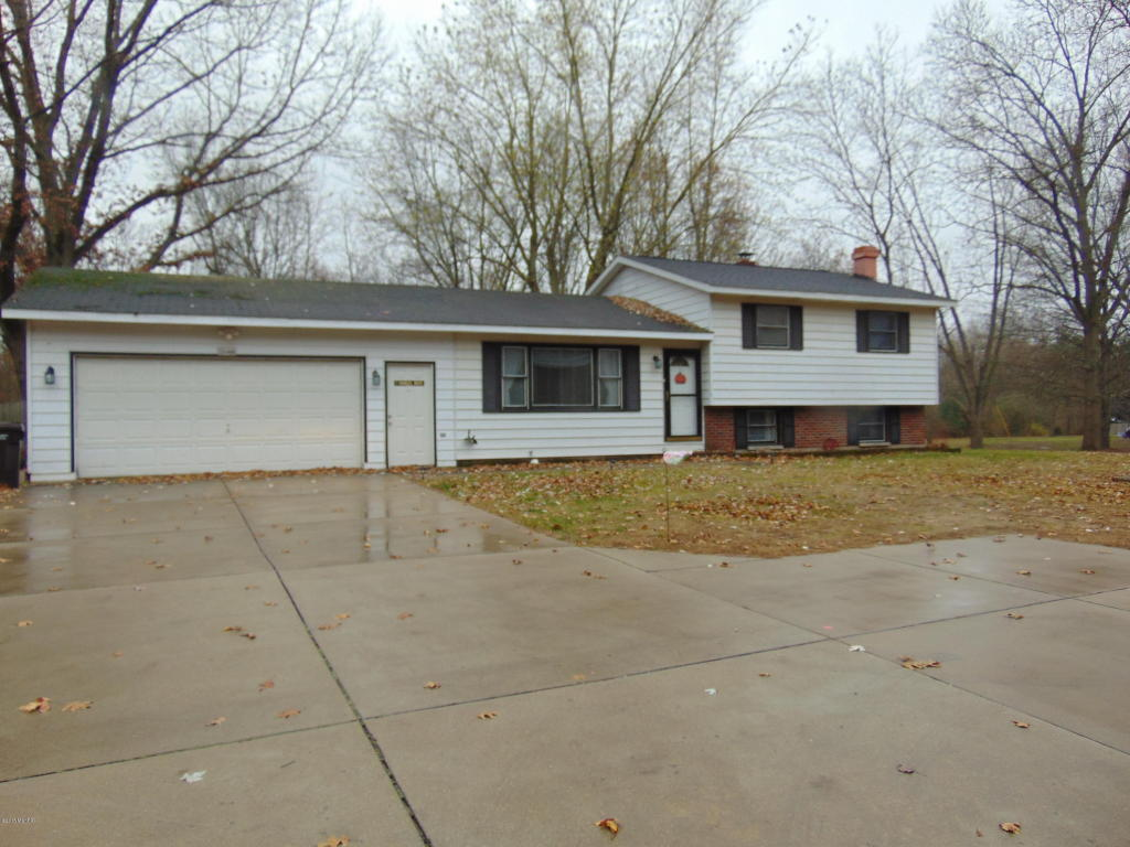 Image is an exterior shot of the described home for sale in Lawton, Michigan.