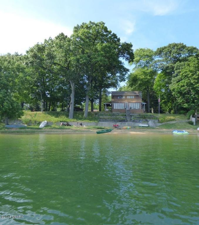Image is an exterior shot of the described home on Big Crooked Lake in Dowagiac, Michigan.