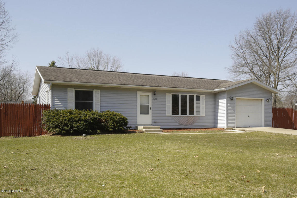 Image is an exterior shot of the described home for sale in Paw Paw, Michigan.