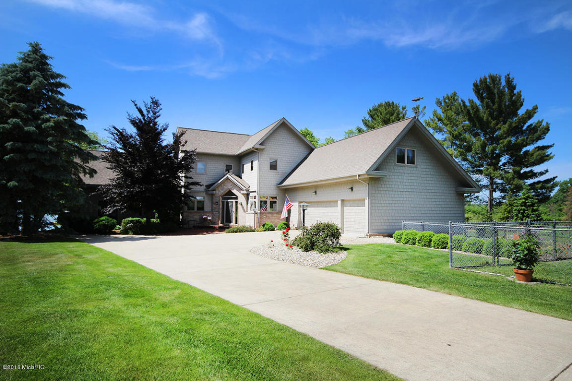 Image is an exterior shot of the described home on Diamond Lake in Cassopolis, Michigan.