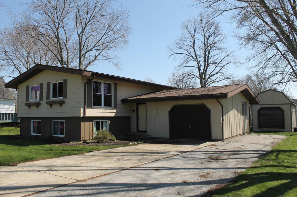 Image is an exterior shot of the described home for sale in Bridgman, Michigan.