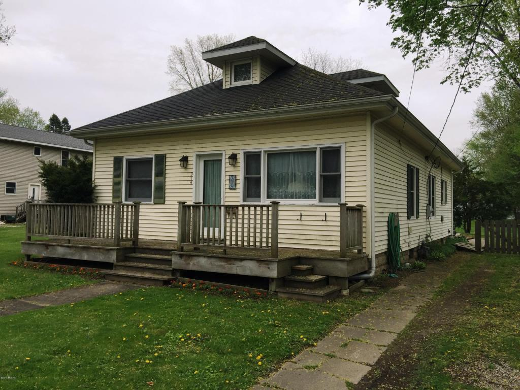 Image is an exterior shot of the described home for sale in Buchanan, Michigan
