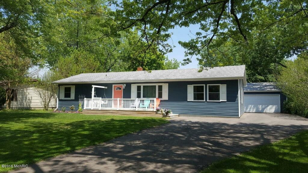 Image is an exterior shot of the described home for sale in St. Joseph, Michigan.