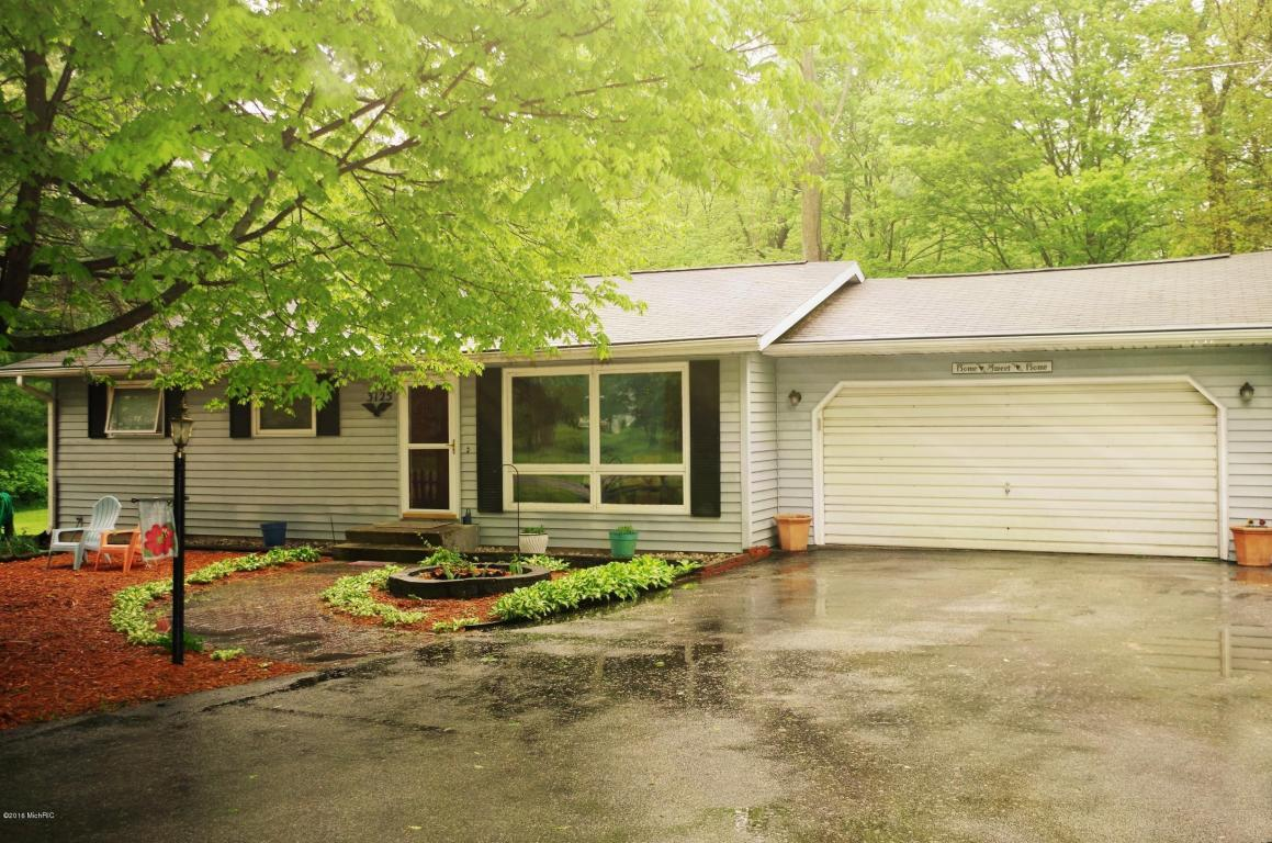 Image is an exterior shot of the described home for sale in Buchanan, Michigan.