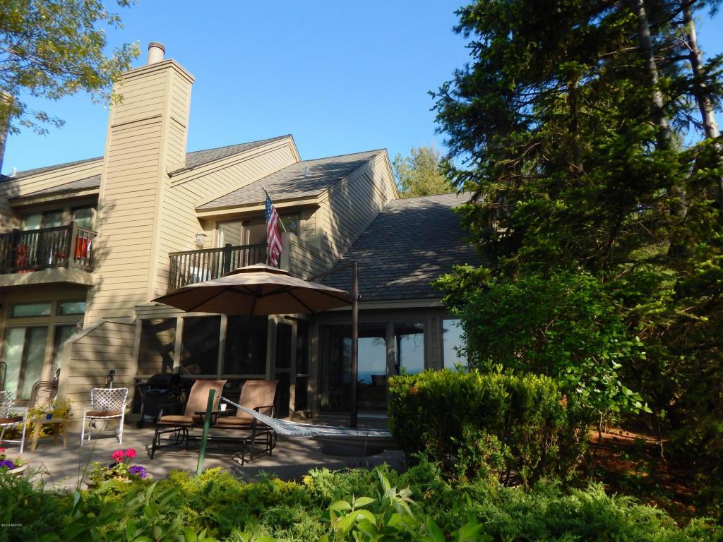 Image is the below described waterfront home for sale on Lake Michigan in New Buffalo, Michigan.