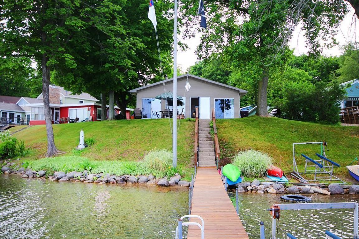 Image is an exterior shot of the below described waterfront Diamond Lake Island home in Cassopolis, Michigan.