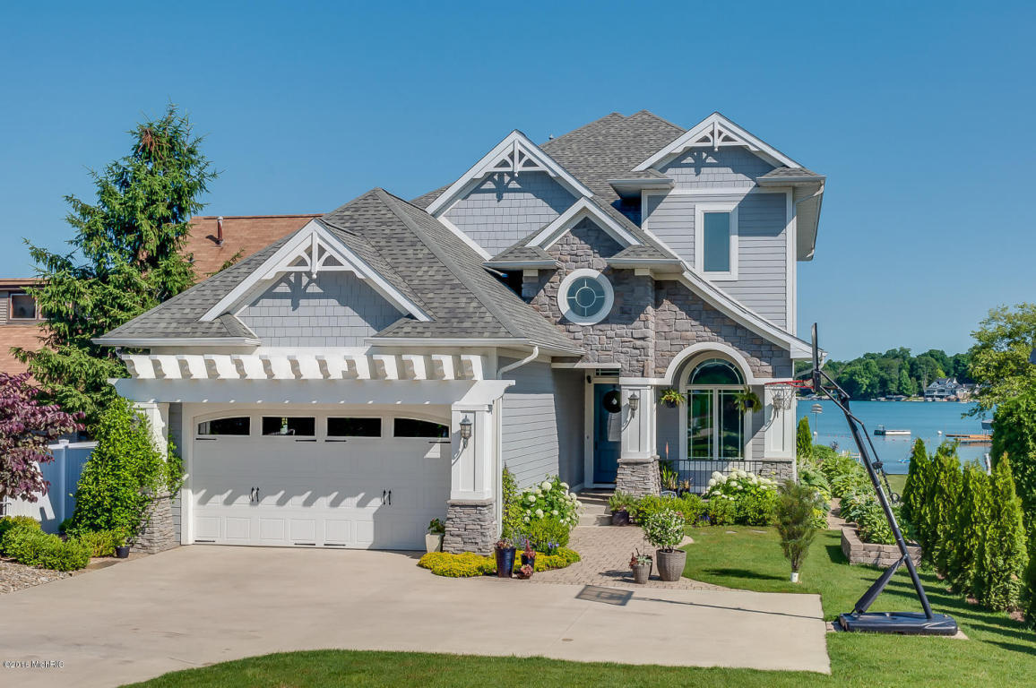 Image is of the below described waterfront home for sale on Diamond Lake in Cassopolis, Michigan.