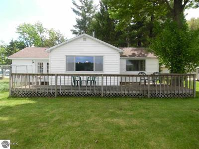 Benzie County, Charlevoix County, Clare County, Emmet County, Grand Traverse County, Kalkaska County, Lake County, Leelanau County, Manistee County, Mason County, Missaukee County, Osceola County, Roscommon County, Wexford County Single Family Home For Sale: 15166 Sanbar Pointe