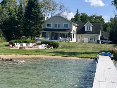 Benzie County, Charlevoix County, Clare County, Emmet County, Grand Traverse County, Kalkaska County, Lake County, Leelanau County, Manistee County, Mason County, Missaukee County, Osceola County, Roscommon County, Wexford County Single Family Home For Sale: 10561 Shore Drive