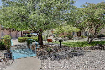 Attached For Sale: 4709 Country Club Lane NE #APT I1