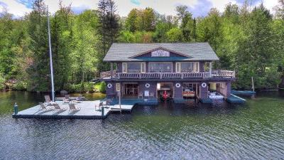 Bloomingdale, Lake Placid, North Elba, Ray Brook, St Armand, Brighton, Franklin, Gabriels, Harrietstown, Lake Clear, Lake Titus, Loon Lake, Onchiota, Paul Smiths, Rainbow Lake, Santa Clara, Saranac Inn, Saranac Lake, Upper Saranac Lake, Vermontville Single Family Home For Sale: 128 Lodge Way