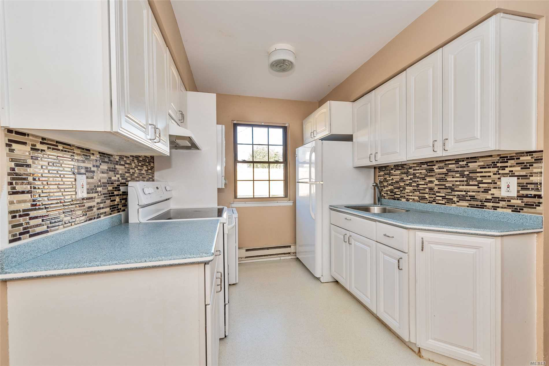 2374 Bedford Ave #A, Bellmore, NY | MLS# 3085995 | Above