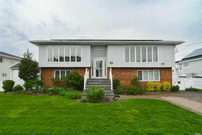 Massapequa Single Family Home For Sale: 64 Beach Rd