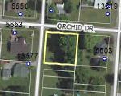 Residential Lots & Land Sold: Orchid Drive NE