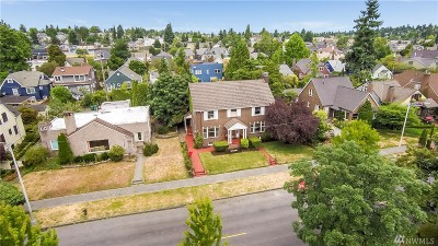 Single Family Home Contingent: 7235 W Green Lake Dr N