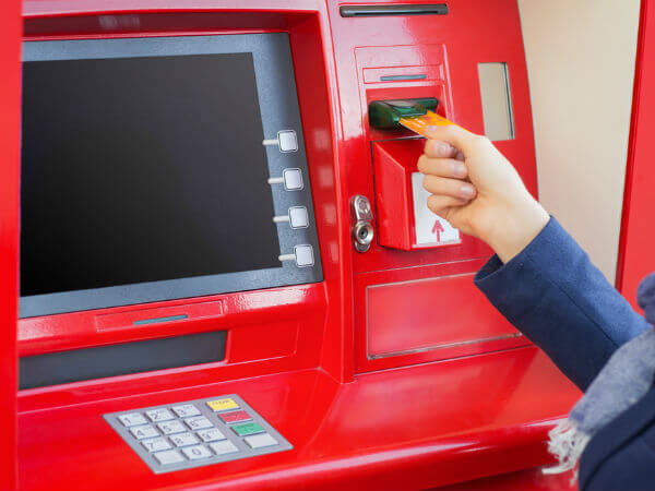Verifying income tax returns using an ATM