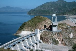 ca. 1991, Pakistan --- Tarbela Dam, along the Indus River, rises 148 meters high and is 2743 meters in length. Completed in 1977, the embankment contains 126,151,570 cubic meters of earth and rock, the largest volume ever used in a structure of its kind. Pakistan. --- Image by © Christine Osborne/CORBIS