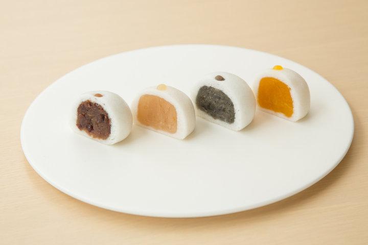 看板商品は色とりどりの野菜餡を使った「運盛饅頭」