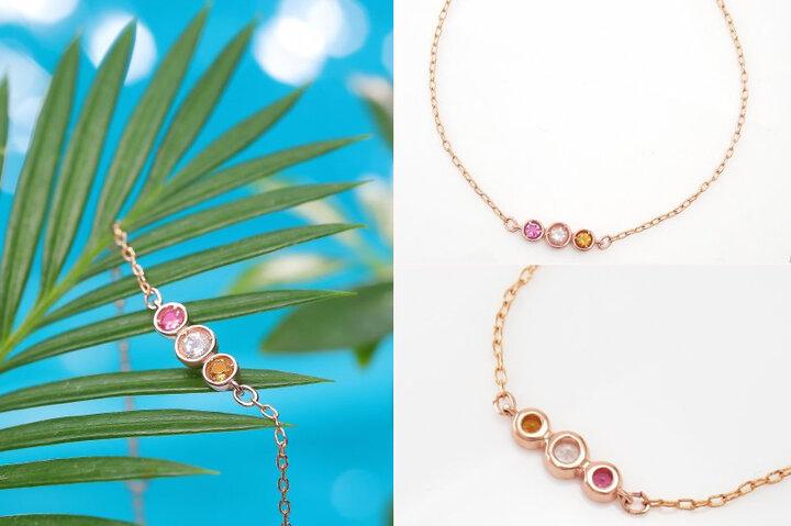 シャンパンゴールドのチェーンと宝石が優しい光を纏います