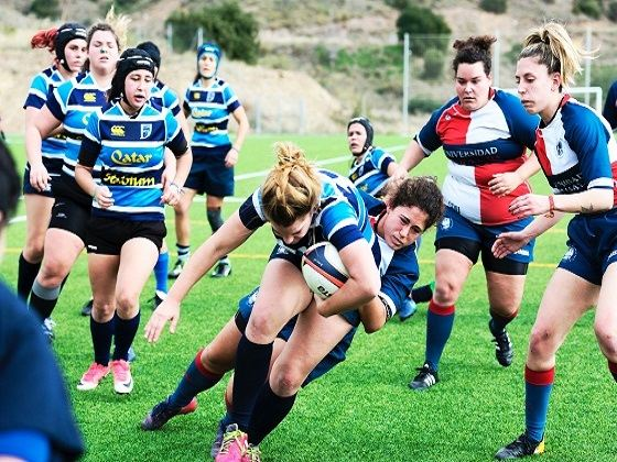 Rugby is played by men with odd shaped balls