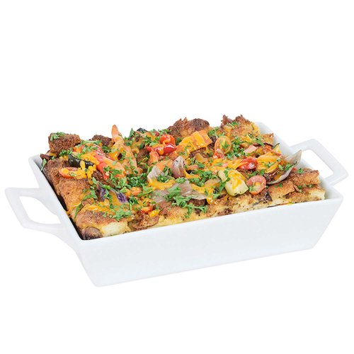 A deep dish savory bread and egg pudding created by our chefs with fresh seasonal vegetables, assorted breakfast meats and imported cheese.  Served with a pan of gravy.   Serves 6-8