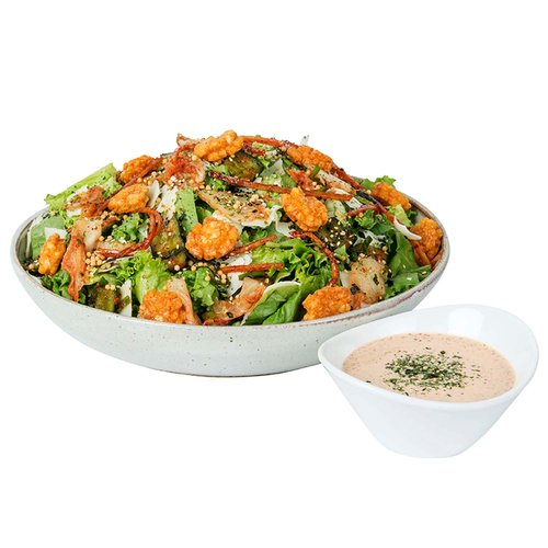 """Our """"bambucha"""" salad bowls are freshly prepared with produce from our store, using seasonal and local ingredients whenever possible. <br><br>   Kim Chee Caesar Salad:  Chopped romaine, wonbok and cucumber kim chee, bubu arare, shoyu agemochi, taegu, parmesan cheese.  Served with Spicy Kim Chee Caesar dressing.   <br><br> Add Pulehu Chicken, $8.99 <br><br>   Serves 6-8"""