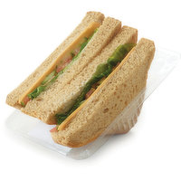 Thick Sliced White or Whole Wheat Bread.  Baba Ghanouj Spread, Cheddar Cheese Slice, Sliced Cucumber, Sliced Roma Tomato and Leaf Lettuce.
