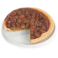 Baked in store. Rich with brown sugar and a sweet syrup cooked into a thick jam-like treat, it's topped with rings of pecans, all encased in  a buttery crust.