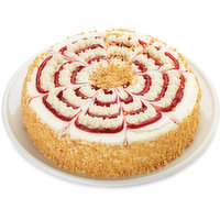 Two layers of Moist Vanilla Sponge Cake are Filled with Custard and Iced with Sweet vanilla Icing. Garnished with Tantalizing Swirl of Tart Raspberry filling. The sides & center with Vanilla Cookie. Keep Refrigerated