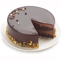 Heavenly Moist and Fudgy Chocolate Cake Perfect for Celebrations. Decadent chocolate sponge cake smothered in rich chocolate ganache drenched with more ganache surrounded with roasted almonds.