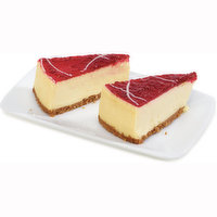 2 Sliced Pieces of our Raspberry Cheesecakes. Delicate Graham Crumb Crust is Filled with a Rich Philadelphia Cream Cheesecake and Smothered with Raspberry Filling with White Chocolate Swirl.