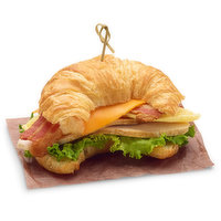 Egg patty, cooked turkey, bacon & cheddar on a fresh croissant.