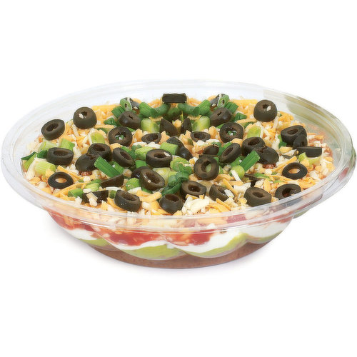 Ready to Serve Tex Mex Cuisine with Refried Beans Guacamole, Sour Cream, Picante Salsa, topped with Sliced  Green Onions and Sliced Black Olives.