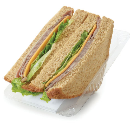 Thick Sliced Whole Wheat of White Bread, Mayonnaise, Roast Beef, Sliced Cheddar Cheese and Leaf Lettuce.