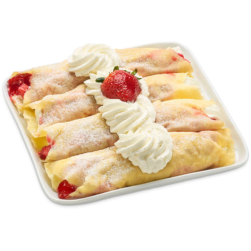 Light, thin Crepes are filled with Real Whipped Cream and Chopped Fresh Fruit(Strawberry's) mixed with Strawberry Glaze. Dusted with Icing Sugar. Finished with Real Whip Cream Rosette and Strawberry.