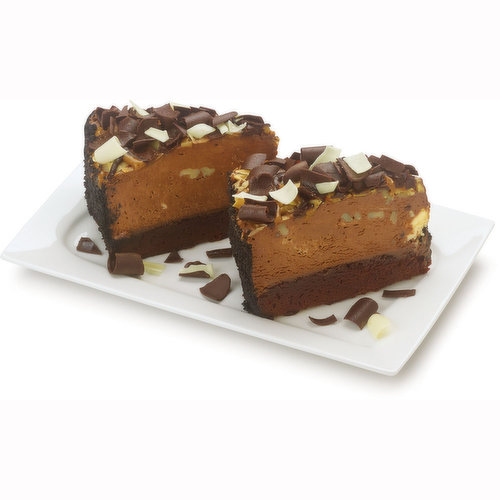 2 Cut Pieces of Decadent Brownie Cake Topped with Dark Chocolate and Filled with a Cheesecake Bite Infused Fudge Filling and Topped off with Almonds, Walnuts and a Mixture of White & Dark Chocolate.