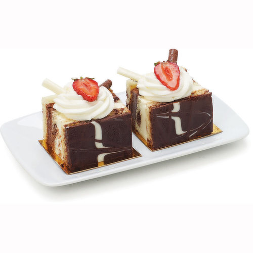 2 Slices of Three Scrumptious Layers Each of Creamy Dark Chocolate and White Chocolate Mousse Floating Between 3 Layers of Marbled White and Dark Chocolate Cake.