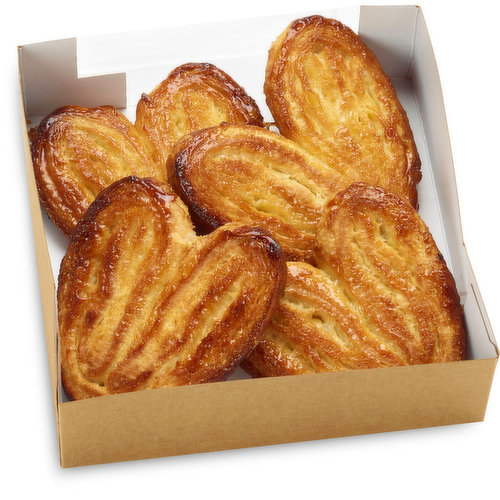 Also known as Palmiers, they're made from puff pastry - similar to the dough used for croissants, but without yeast. They're buttery, flaky, rolled in sugar before baking to get a caramelized crunch.