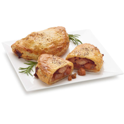 Rich braised beef, roasted vegetables, potatoes, and ale baked in a buttery puff pastry.<br />