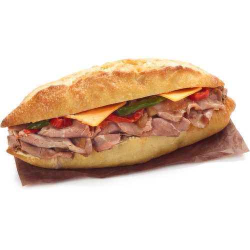 A Tapered End Demi Baguette with Garlic Spread, Mozzarella Slice, In House Roast Beef, Caramilzed Onions, BBQ Sauce, Roasted Red Peppers, Cheddar Cheese, Salt & Pepper.
