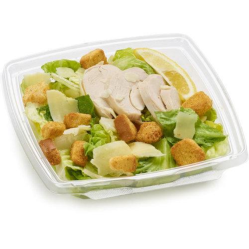 Romaine/Kale Mixture. Chicken Breast Sliced. Parmesan Cheese, Petals. Crouton Packet. Lemon Wedge. Romano Caesar Dressing.