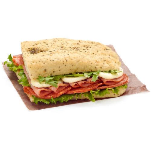 Herb Focaccia Bread with Franks Sauce, Basil Pesto, Green Leaf Lettuce, Pepper Salami, Hot Genoa Salami, Genoa Salami, Tre Stelle Bocconcini Slices, Baby Arugula, Salt & Pepper.