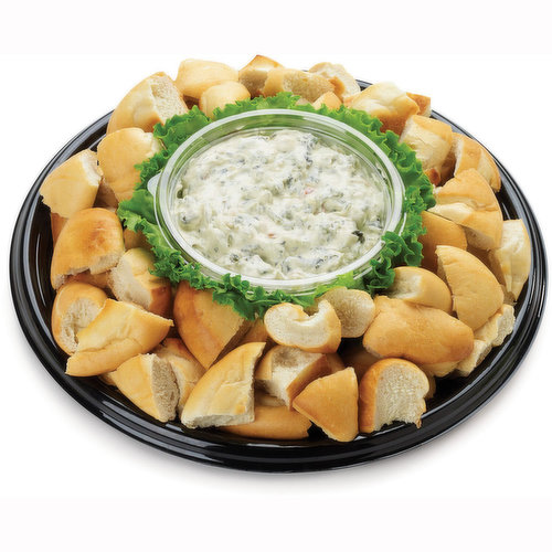 48 hour Prep Time Required for Party Platters. Limit 10 Per Order.Premium Spinach Dip Centered with Freshly Baked Sourdough Loaf. Serves 5-7.