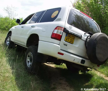 Overland Driving Tips: rear wheel lifting from terrain, next stage is a rollover