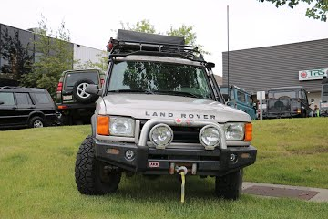 Land Rover with roof top tent and aftermarket lights