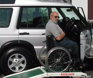 Wheelchair vehicle ramp, going off-roading in his Landy