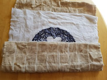 roll in towel washed cross stitch